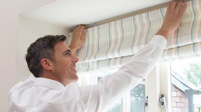 Child safe Roman blind being fitted