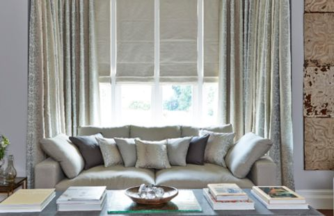 Grey Roman Blind in a Living Room Window