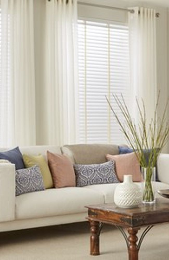 White Wooden Blinds and White Voiles in Living Room