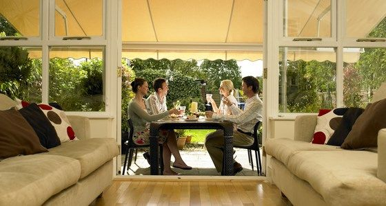 Cream Awning Against Patio area -