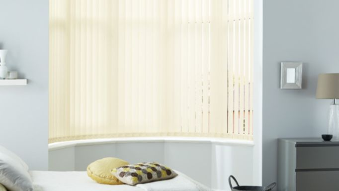 Bedroom Blind Ideas - Yellow Vertical Blind in a bedroom bay window