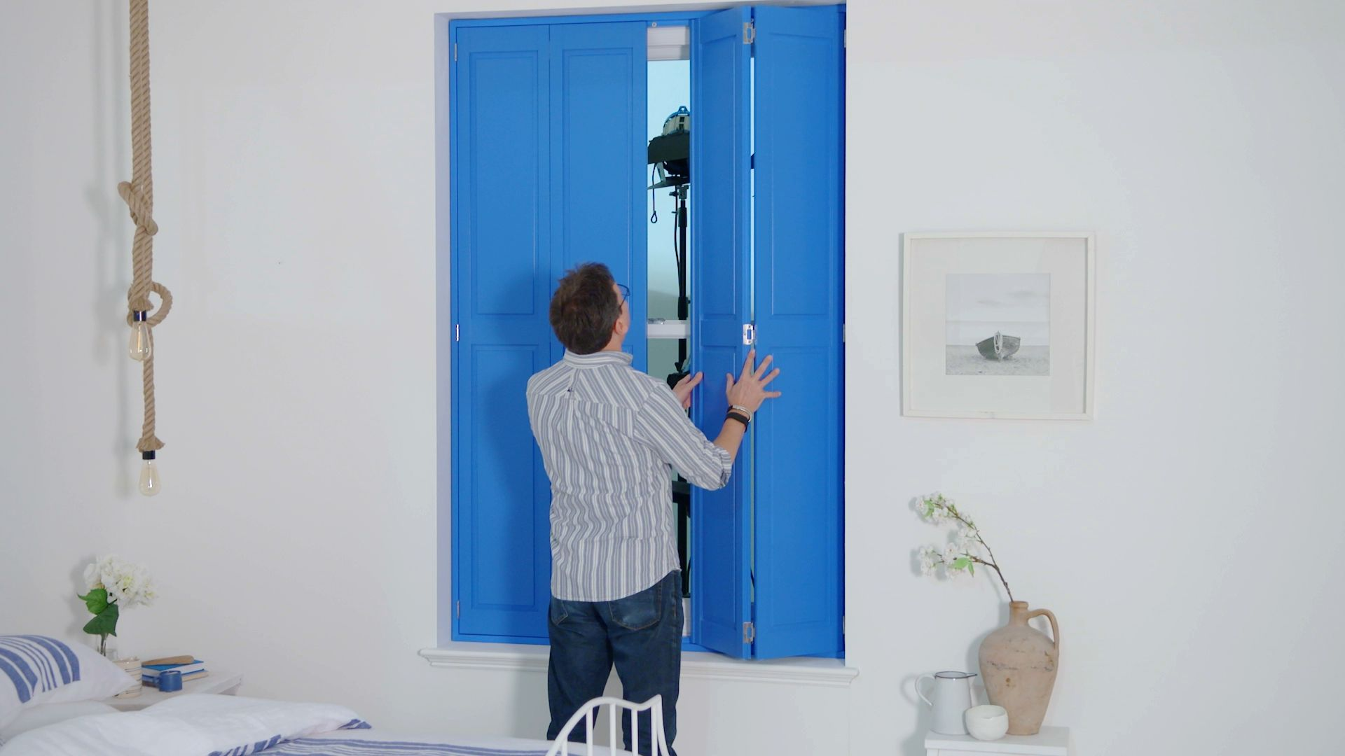 Blue bedroom shutters -