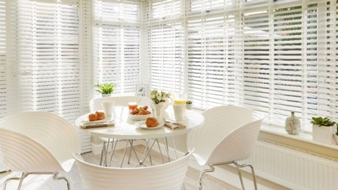 White Wooden Blinds In White Conservatory