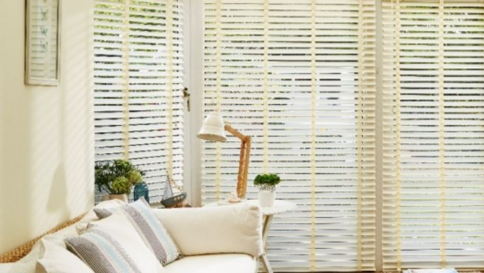 Ivory faux wood blinds with matching tape conservatory