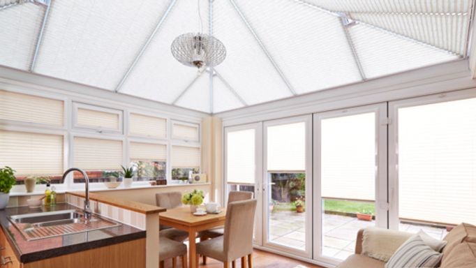 Montoya Sand Pleated blind on a conservatory roof