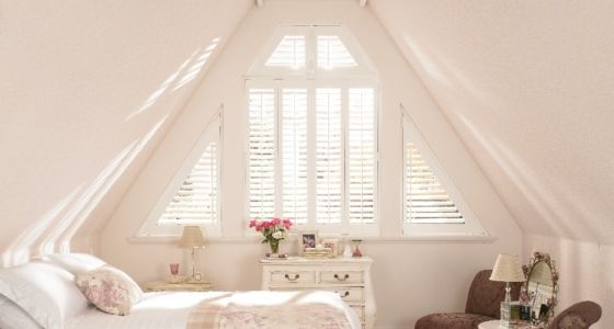 Wooden shutter on unusual shaped loft conversion window -