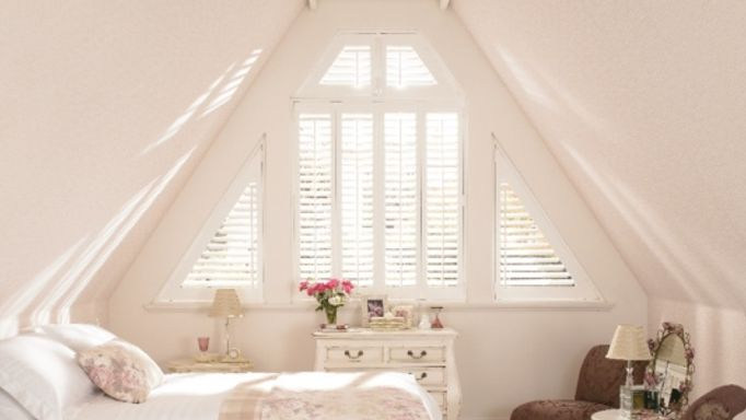 Wooden shutter on unusual shaped loft conversion window