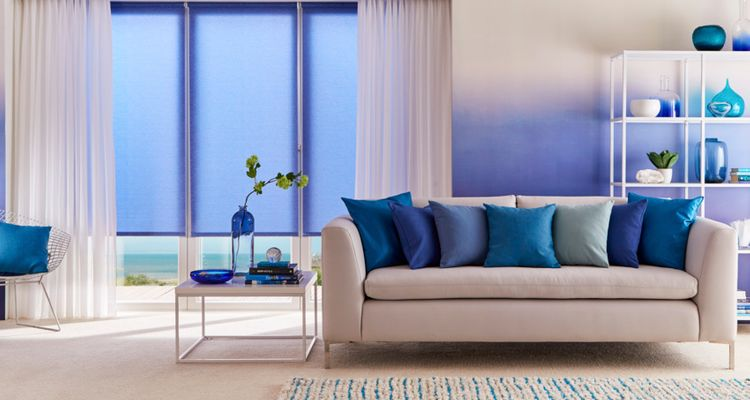 Ravenna Royal Blue Roller blind with Lyra White Voile curtains living room