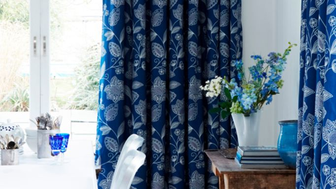 Blue floral curtains over french door