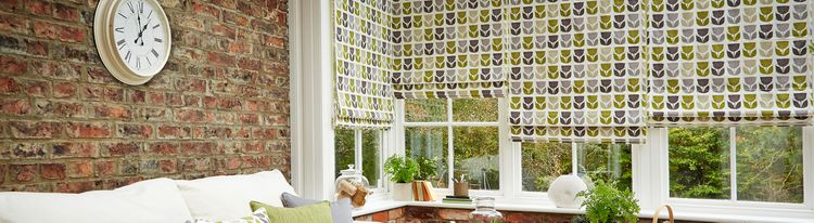green-roman-blind-conservatory-rayna-apple.jpg