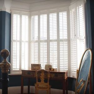 Haywood Purity Shutters in a Living Room Bay Window