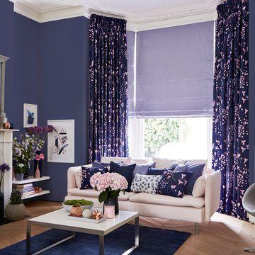 Blue Pencil Pleat Curtain combined with a Purple Roman Blind in living-room - Sorano Indigo Pencil Pleat curtains and Radiance Lavander