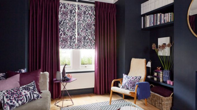 Charlotte Beevor Radiance Berry Red pinch pleat curtains combined with a Sorana Violet Floral Roman blind in the living room