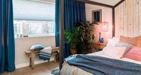 Scandi luxe design bedroom with blue thermal blinds