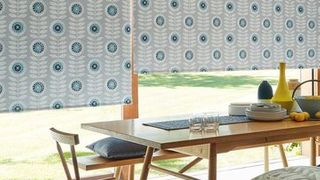 Blue roller blind in the dining room--NEISHA-TEAL