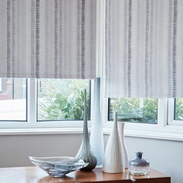 Grey striped roller blind in living room--DASH-MONOCHROME