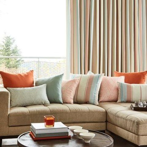 Mishma Dawn Beige Curtains in the Living Room with Sofa and Pastel Coloured Cushions
