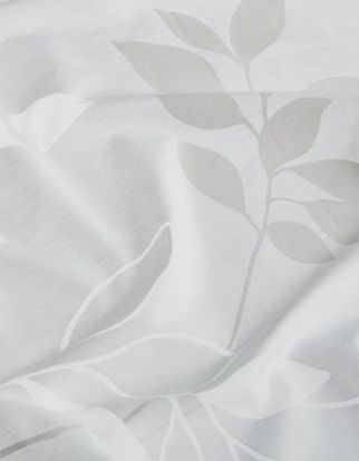White swirling curtain fabric with a leaf pattern