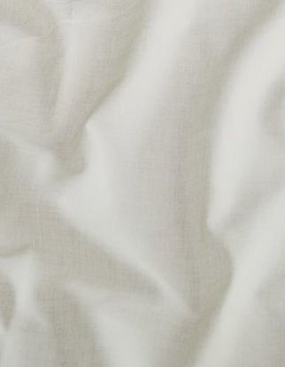 Cream coloured swirling fabric