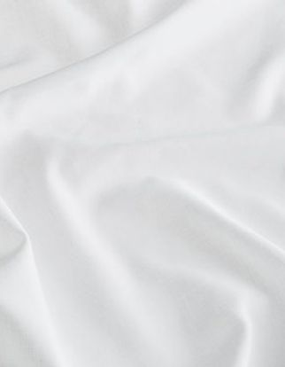 White coloured fabric swirled on a surface